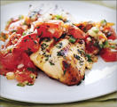 Grilled chicken and tomato based sauce with olive oil